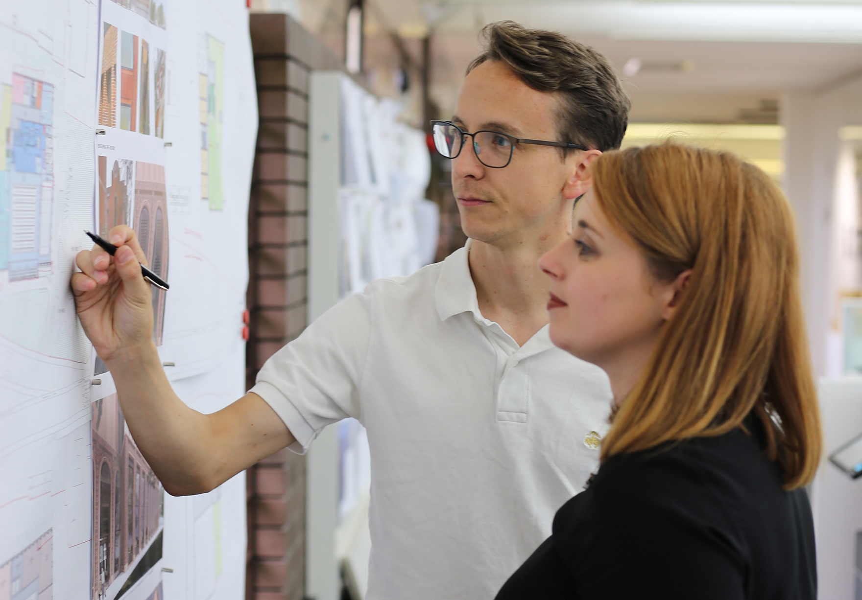 Laura Mcclorey And Nick Heyward Looking Reviewing Architectural Designs On Crit Wall Lh